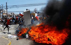 Al menos cuatro imputados por quemar carpas de migrantes venezolanos en Chile