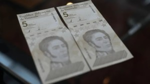 Venezuela burns through cash to shore up new bolivar